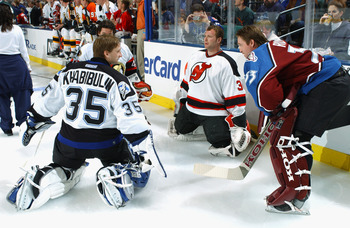 SUNRISE, FL - FEBRUARY 1:  Goaltenders Nikolai Khabibulin #35, Patrick Roy #33, Martin Brodeur #30 and Patrick Lalime #40 hang out during the NHL All-Star SuperSkills competition at the Office Depot Center on February 1, 2003 in Sunrise, Florida.  (Photo