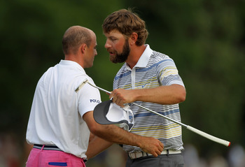 CHARLOTTE, NC - MAY 08:  Lucas Glover (R) shakes hands with Jonathan Byrd on the 18th green after defeating Byrd on the first playoff hole during the final round of the Wells Fargo Championship at the Quail Hollow Club on May 8, 2011 in Charlotte, North C