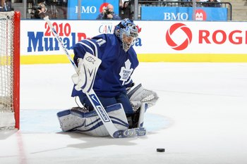 TORONTO - APRIL 8: Goalie Curtis Joseph #31 of the Toronto Maple Leafs stops the puck against the Buffalo Sabres during their NHL game at the Air Canada Centre on April 8, 2009 in Toronto, Ontario. (Photo by: Dave Sandford/Getty Images)