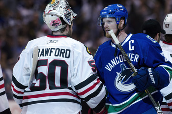 VANCOUVER, CANADA - APRIL 26: Henrik Sedin #33 (R) of the Vancouver Canucks and goalie Corey Crawford #50 of the Chicago Blackhawks shake hands after the Canucks defeated the Blackhawks 2-1 in overtime of Game Seven of the Western Conference Quarterfinals