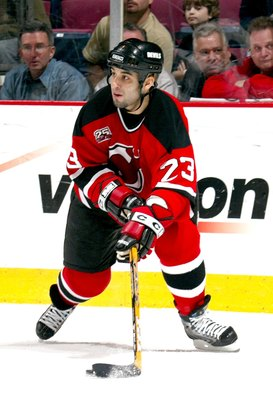 EAST RUTHERFORD, NJ - APRIL 20:  Scott Gomez #23 of the New Jersey Devils skates with the puck during Game 5 of the 2007 Eastern Conference Quarterfinals against Tampa Bay Lightning on April 20, 2007 at Continental Airlines Arena in East Rutherford, New J