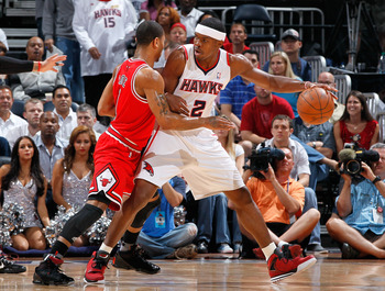 ATLANTA, GA - MAY 08:  Joe Johnson #2 of the Atlanta Hawks drives against Derrick Rose #1 of the Chicago Bulls in Game Four of the Eastern Conference Semifinals in the 2011 NBA Playoffs at Phillips Arena on May 8, 2011 in Atlanta, Georgia.  NOTE TO USER: