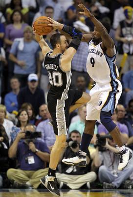 MEMPHIS, TN - APRIL 23:  Manu Ginobili #3 of the San Antonio Spurs passes the ball while defended by Tony Allen #9 of the Memphis Grizzlies in Game three of the Western Conference Quarterfinals in the 2011 NBA Playoffs at FedExForum on April 23, 2011 in M