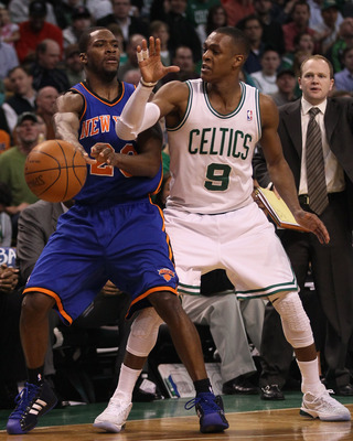 BOSTON, MA - APRIL 19:  Toney Douglas #23 of the New York Knicks tries to pass as Rajon Rondo #9 of the Boston Celtics defends in Game Two of the Eastern Conference Quarterfinals in the 2011 NBA Playoffs on April 19, 2011 at the TD Garden in Boston, Massa