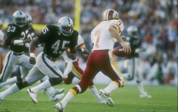 22  Jan 1984:   Quarterback Joe Theismann #7 of the Washington Redskins keeps moving during Super Bowl XVIII against the Los Angeles Raiders at Tampa Stadium in Tampa, Florida.The Raiders won the game 38-9. Mandatory Credit: Allsport  /Allsport