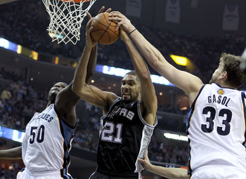 MEMPHIS, TN - APRIL 29:  Zach Randolph #50 and Marc Gasol #33 of the Memphis Grizzlies and Tim Duncan #21 of the San Antonio Spurs reach for a rebound in Game Six of the Western Conference Quarterfinals in the 2011 NBA Playoffs at FedExForum on April 29,