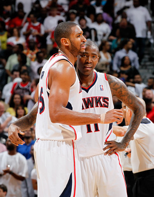 ATLANTA, GA - MAY 08:  Al Horford #15 and Jamal Crawford #11 of the Atlanta Hawks react in the final seconds of their 100-88 win over the Chicago Bulls in Game Four of the Eastern Conference Semifinals in the 2011 NBA Playoffs at Phillips Arena on May 8,