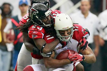 ATLANTA - SEPTEMBER 19:  Dunta Robinson #23 of the Atlanta Falcons tackles Larry Fitzgerald #11 of the Arizona Cardinals at Georgia Dome on September 19, 2010 in Atlanta, Georgia.  (Photo by Kevin C. Cox/Getty Images)