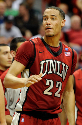 LAS VEGAS, NV - MARCH 11:  Chace Stanback #22 of the UNLV Rebels greets teammates during a timeout in a semifinal game of the Conoco Mountain West Conference Basketball tournament against the San Diego State Aztecs at the Thomas & Mack Center March 11, 20