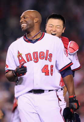 ANAHEIM, CA - MAY 06:  Torii Hunter #48 of the Los Angeles Angels of Anaheim is congratulated by Hank Conger #16 after hitting the game wining RBI single against the Cleveland Indians in the 11th inning at Angel Stadium of Anaheim on May 6, 2011 in Anahei
