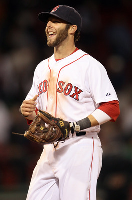 BOSTON, MA - MAY 02:  Dustin Pedroia #15 of the Boston Red Sox celebrates the win over the Los Angeles Angels on May 2, 2011 at Fenway Park in Boston, Massachusetts. The Boston Red Sox defeated the Los Angeles Angels 9-5.  (Photo by Elsa/Getty Images)