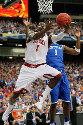 ATLANTA, GA - MARCH 12:  Tony Mitchell #5 of the Alabama Crimson Tide shoots against Darius Miller #1 of the Kentucky Wildcats during the semifinals of the SEC Men's Basketball Tournament at Georgia Dome on March 12, 2011 in Atlanta, Georgia.  (Photo by K