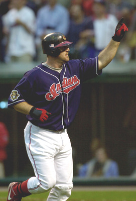 13 Oct 2001:  Jim Thome #25 of the Cleveland Indians acknowledges the crowd as he heads to the dugout after hitting a homne run in the sixth inning against the Seattle Mariners during game three of the American League Division Series at Jacobs Field in Cl