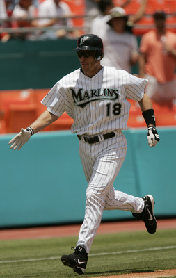 MIAMI - JULY 29:  Left fielder Jeff Conine #18 of the Florida Marlins celebrates his homerun in the second inning against the Philadelphia Phillies on July 29, 2004 at Pro Player Stadium in Miami, Florida.  The Marlins defeated the Phillies 10-1. (Photo b