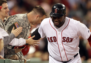 BOSTON, MA - MAY 02:  David Ortiz #34 of the Boston Red Sox celebrates his two run homer with military members sitting in the front row in the seventh inning against the Los Angeles Angels on May 2, 2011 at Fenway Park in Boston, Massachusetts.  (Photo by