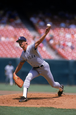 ANAHEIM, CA - 1987:  Ron Guidry #49 of the New York Yankees pitches during a game in the 1987 season against the California Angels at Anaheim Stadium in Anaheim, California.  (Photo by Tim DeFrisco/Getty Images)