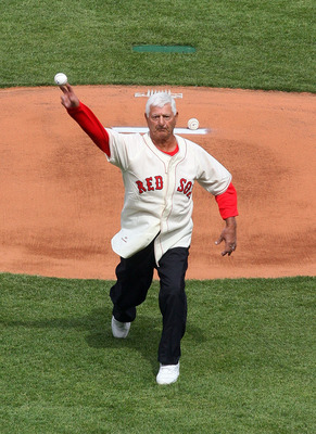 BOSTON, MA - APRIL 8:   Former Boston Red Sox Carl Yastrzemski throws out the first pitch before the game against teh New York Yankees on Opening Day at Fenway Park on April 8, 2011 in Boston, Massachusetts. (Photo by Gail Oskin/Getty Images)