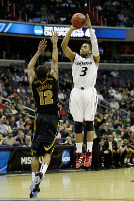 WASHINGTON - MARCH 17:  Dion Dixon #3 of the Cincinnati Bearcats shoots over Marcus Denmon #12 of the Missouri Tigers during the second round of the 2011 NCAA men's basketball tournament at the Verizon Center on March 17, 2011 in Washington, DC.  (Photo b