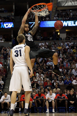 DENVER, CO - MARCH 19:  Robert Sacre #00 of the Gonzaga Bulldogs dunks the ball over Kyle Collinsworth #31 of the Brigham Young Cougars during the third round of the 2011 NCAA men's basketball tournament at Pepsi Center on March 19, 2011 in Denver, Colora
