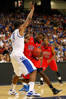ATLANTA, GA - MARCH 11:  Terrance Henry #1 of the Ole Miss Rebels drives against Terrence Jones #3 of the Kentucky Wildcats during the quarterfinals of the SEC Men's Basketball Tournament at Georgia Dome on March 11, 2011 in Atlanta, Georgia.  (Photo by K