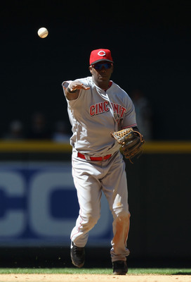 PHOENIX, AZ - APRIL 10:  Iniflder Edgar Renteria #16 of the Cincinnati Reds fields a ground ball out against the Arizona Diamondbacks during the Major League Baseball game at Chase Field on April 10, 2011 in Phoenix, Arizona.  The Diamondbacks defeated th