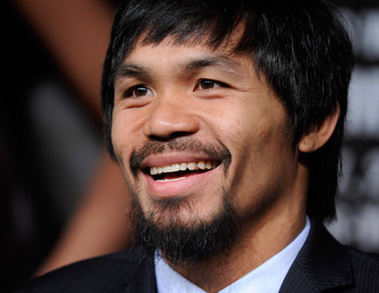 LAS VEGAS, NV - MAY 04:  Boxer Manny Pacquiao smiles during the final news conference for his bout against Shane Mosley at the MGM Grand Hotel/Casino May 4, 2011 in Las Vegas, Nevada. Pacquiao will defend his WBO welterweight title against Mosley on May 7