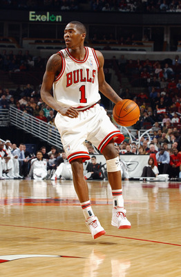 CHICAGO - FEBRUARY 12:  Jamal Crawford #1 of the Chicago Bulls moves the ball during the game against the Boston Celtics at the United Center on February 12, 2004 in Chicago, Illinois. The Bulls won 107-87. NOTE TO USER: User expressly acknowledges and ag