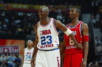 ATLANTA, GA - FEBRUARY 9:  Michael Jordan (Washington Wizards) #23 of the Eastern Conference All-Stars jokes with Kobe Bryant (Los Angeles Lakers) #8 of the Western Conference All-Stars during the 2003 NBA All-Star Game on February 9, 2003 at Philips Aren
