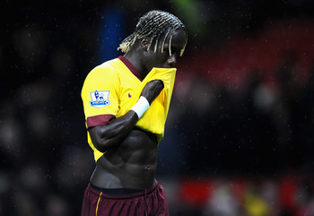 MANCHESTER, ENGLAND - MARCH 12:  Bacary Sagna of Arsenal looks dejected after defeat in the FA Cup sponsored by E.On Sixth Round match between Manchester United and Arsenal at Old Trafford on March 12, 2011 in Manchester, England.  (Photo by Clive Mason/G