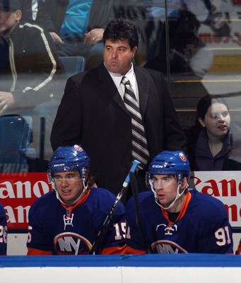 UNIONDALE, NY - NOVEMBER 17: Head coach Jack Capuano of the New York Islanders works the bench during his first NHL game against the Tampa Bay Lightning at the Nassau Coliseum on November 17, 2010 in Uniondale, New York. (Photo by Bruce Bennett/Getty Imag