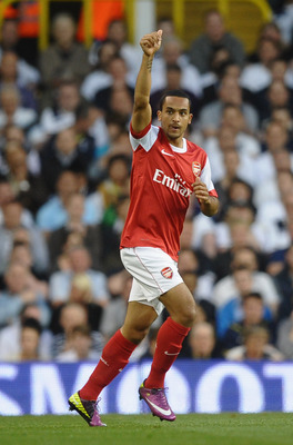 LONDON, ENGLAND - APRIL 20:  Theo Walcott of Arsenal celebrates scoring the opening goal during the Barclays Premier League match between Tottenham Hotspur and Arsenal at White Hart Lane on April 20, 2011 in London, England.  (Photo by Laurence Griffiths/