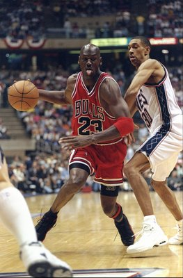 29 Apr 1998: Michael Jordan #23 of the Chicago Bulls in action against Kerry Kittles #30 of the New Jersey Nets during the NBA Playoffs round 3 game at the Continental Airlines Arena in East Rutherford, New Jersey. The Bulls defeated the Nets 116-101.