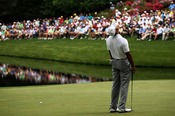 AUGUSTA, GA - APRIL 08:  Tiger Woods reacts to missing a putt on the 16th hole during the second round of the 2011 Masters Tournament at Augusta National Golf Club on April 8, 2011 in Augusta, Georgia.  (Photo by Jamie Squire/Getty Images)