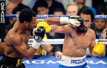 LAS VEGAS, NV - MAY 07:  Shane Mosley (L) and Manny Pacquiao battle in the fifth round of their WBO welterweight title fight at the MGM Grand Garden Arena May 7, 2011 in Las Vegas, Nevada. Pacquiao retained his title with a unanimous-decision victory.  (P