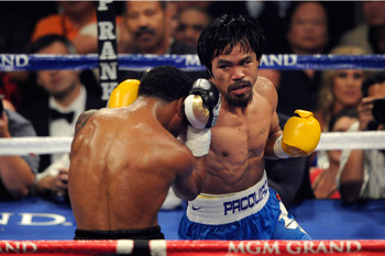 LAS VEGAS, NV - MAY 07:  (R-L) Manny Pacquiao of the Philippines throws a right at Shane Mosley in the WBO welterweight title fight at MGM Grand Garden Arena on May 7, 2011 in Las Vegas, Nevada.  (Photo by Ethan Miller/Getty Images)