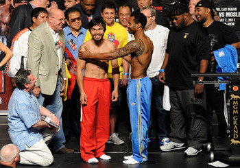 LAS VEGAS, NV - MAY 06:  (L-R) Boxers Manny Pacquiao of the Philippines and Shane Mosley greet each other after the weigh-in for their WBO welterweight title fight at MGM Grand Garden Arena on May 6, 2011 in Las Vegas, Nevada. Pacquiao will defend his WBO