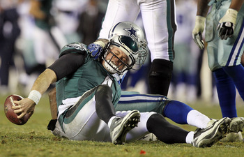 PHILADELPHIA, PA - JANUARY 02:  Kevin Kolb #4 of the Philadelphia Eagles is sacked by DeMarcus Ware #94 of the Dallas Cowboys on January 2, 2011 at Lincoln Financial Field in Philadelphia, Pennsylvania. The Cowboys defeated the Eagles 14-13.  (Photo by Ji