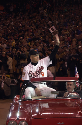 BALTIMORE - OCTOBER 6:  Cal Ripken Jr. #8 of the Baltimore Orioles waves to the crowd, while riding in a car, during the October 6, 2001 ceremony to honor Ripken's 3001st and final game of his career. After the ceremony, the Baltimore Orioles would lose t