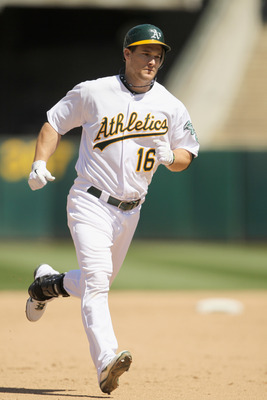 OAKLAND, CA - MAY 02:  Josh Willingham #16 of the Oakland Athletics rounds the bases after hitting a home run in the eighth inning to tie their game against the Texas Rangers at Oakland-Alameda County Coliseum on May 2, 2011 in Oakland, California.  (Phot