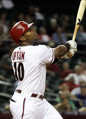 PHOENIX, AZ - MAY 05: Justin Upton #10 of the Arizona Diamondbacks hits the game winning RBI single against the Colorado Rockies during the 11th inning of the Major League Baseball game at Chase Field on May 5, 2011 in Phoenix, Arizona.  The Diamondbacks