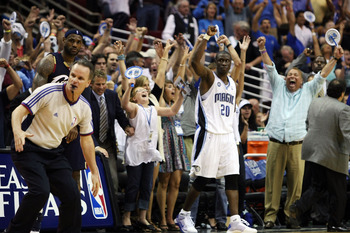 ORLANDO, FL - MAY 26:  Mickael Pietrus #20 of the Orlando Magic and fans celebrate their 116-114 victory over the Cleveland Cavaliers in Game Four of the Eastern Conference Finals during the 2009 NBA Playoffs at the Amway Arena on May 26, 2009 in Orlando,