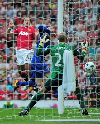 MANCHESTER, ENGLAND - APRIL 23: Javier Hernandez of Manchester United heads the opening goal during the Barclays Premier League match between Manchester United and Everton at Old Trafford on April 23, 2011 in Manchester, England.  (Photo by Shaun Botteril
