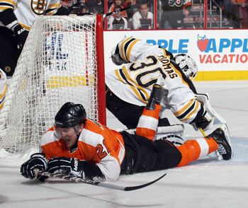 PHILADELPHIA, PA - APRIL 30:  Tim Thomas #30 of the Boston Bruins makes the save on James van Riemsdyk #21 of the Philadelphia Flyers in Game One of the Eastern Conference Semifinals during the 2011 NHL Stanley Cup Playoffs at the Wells Fargo Center on Ap