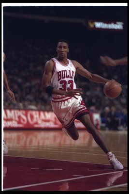 9 Dec 1992: Forward Scottie Pippen of the Chicago Bulls moves the ball during a game against the Cleveland Cavaliers at the United Center in Chicago, Illinois.
