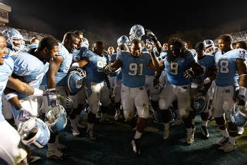 CHAPEL HILL, NC - NOVEMBER 07:  Teammates Marivn Austin #9 and Quinton Coples #90 of the North Carolina Tar Heels celebrate with teammates after a 19-6 victory over the Duke Blue Devils during their game at Kenan Stadium on November 7, 2009 in Chapel Hill