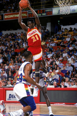 1990:  Dominique Wilkins #21 of the Atlanta Hawks collects a rebound during a 1990-1991 NBA season game against the Denver Nuggets.  (Photo by Tim DeFrisco/Getty Images)