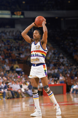 DENVER, CO- 1988:  Fat Lever #12 of the Denver Nuggets looks to pass the ball during a game in the 1988 -1989 NBA Season. NOTE TO USER: User expressly acknowledges and agrees that, by downloading and/or using this Photograph, User is consenting to the ter