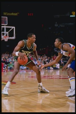 1989-1990:  Guard Alvin Robertson of the Milwaukee Bucks (left) in action with the ball during a game against the Denver Nuggets at McNichols Arena in Denver, Colorado. Mandatory Credit: Tim de Frisco  /Allsport