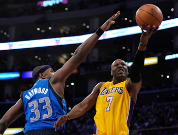 LOS ANGELES, CA - MAY 04:  Lamar Odom #7 of the Los Angeles Lakers goes up for a shot against Brendan Haywood #33 of the Dallas Mavericks in the second half in Game Two of the Western Conference Semifinals in the 2011 NBA Playoffs at Staples Center on May