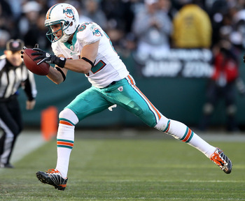 OAKLAND, CA - NOVEMBER 28:  Brian Hartline #82 of the Miami Dolphins in action against the Oakland Raiders at Oakland-Alameda County Coliseum on November 28, 2010 in Oakland, California.  (Photo by Ezra Shaw/Getty Images)